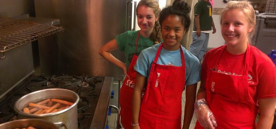Serving a meal in Denver summer work camp