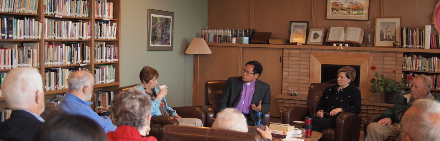 Bishop Pascua in discussion in fireside room about the Philippines