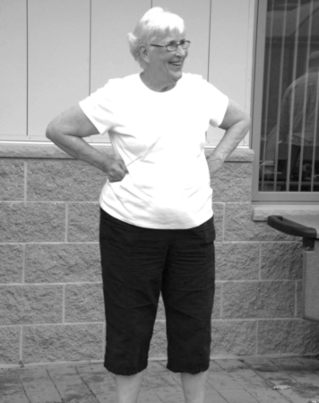 Mary standing with hands on hips