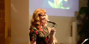 Susan Kidd Larson singing with a smile