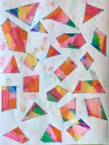 Rainbow colored shapes floating on white